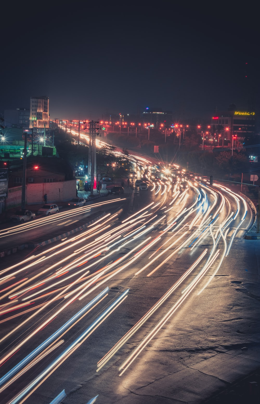 time lapse photography of vehicles passing during night time