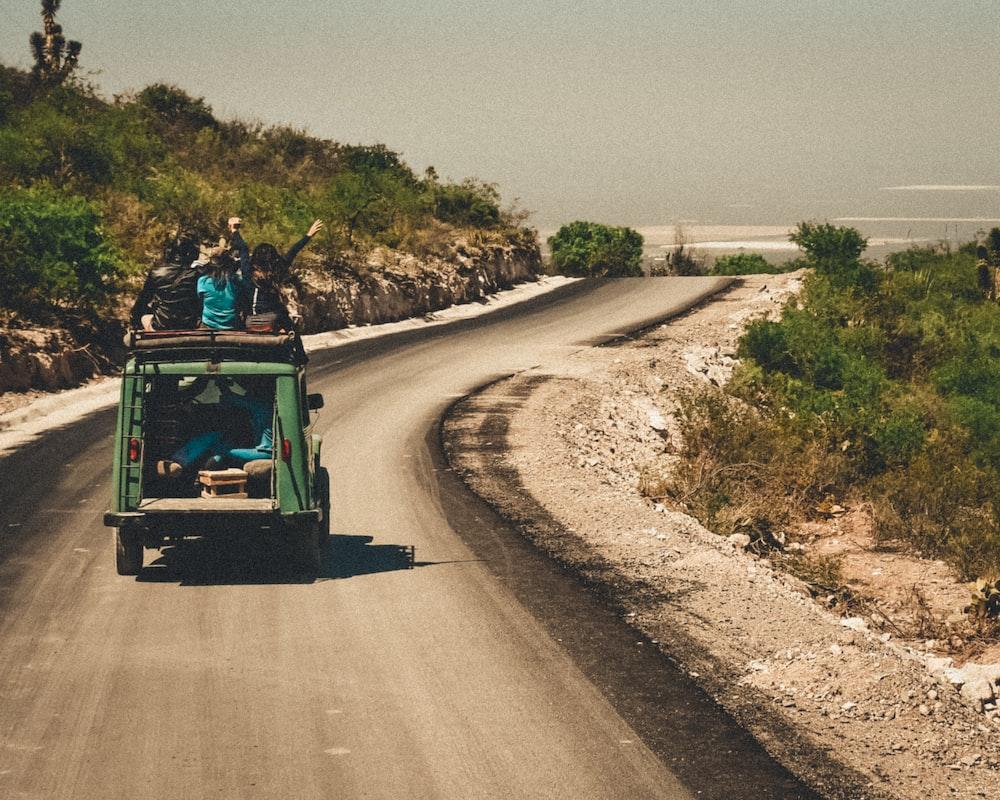 green vehicle crossing on roa