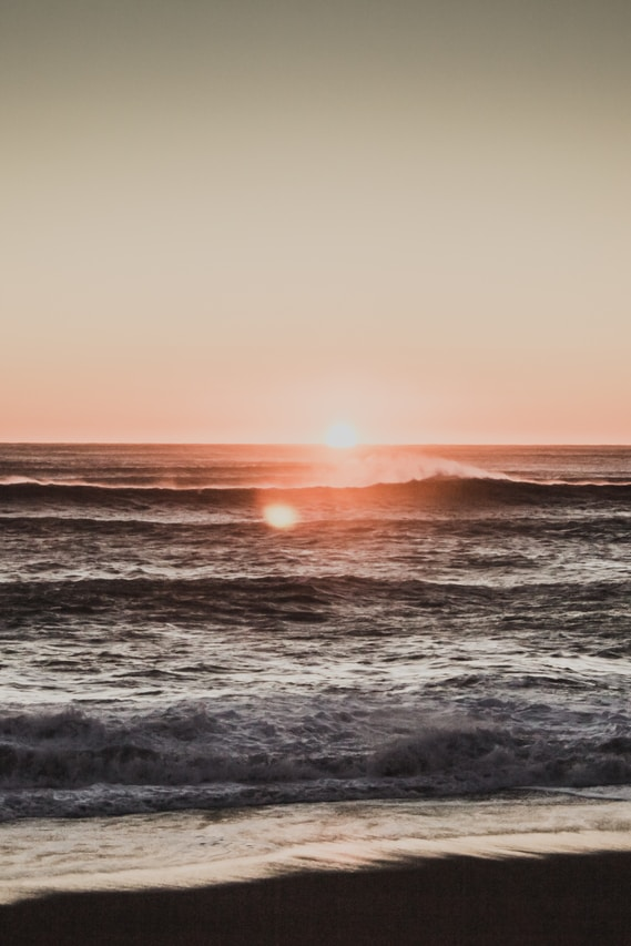 sea wave during golden hour