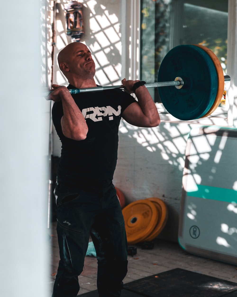 man carrying barbell