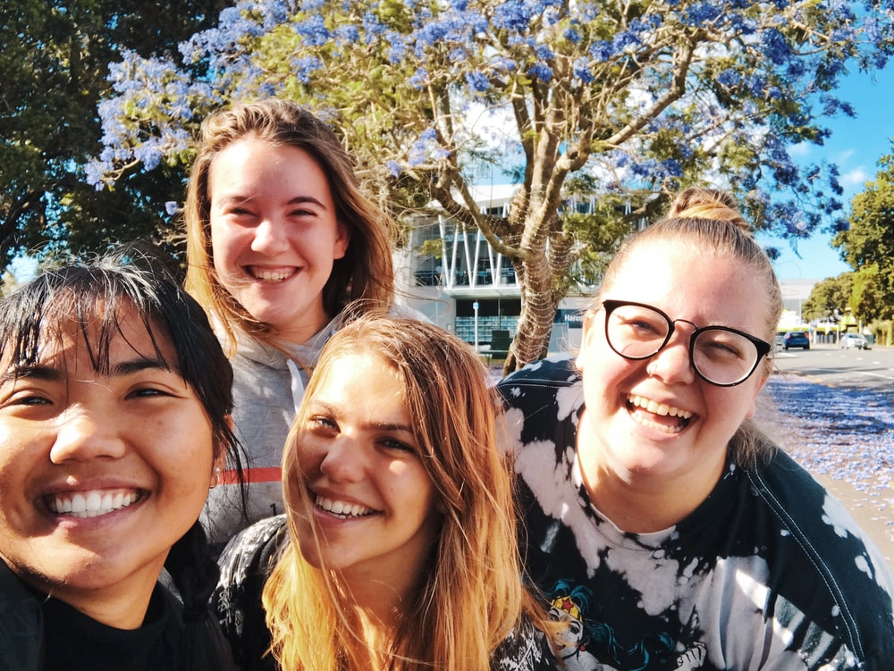four girl smiling outdoor