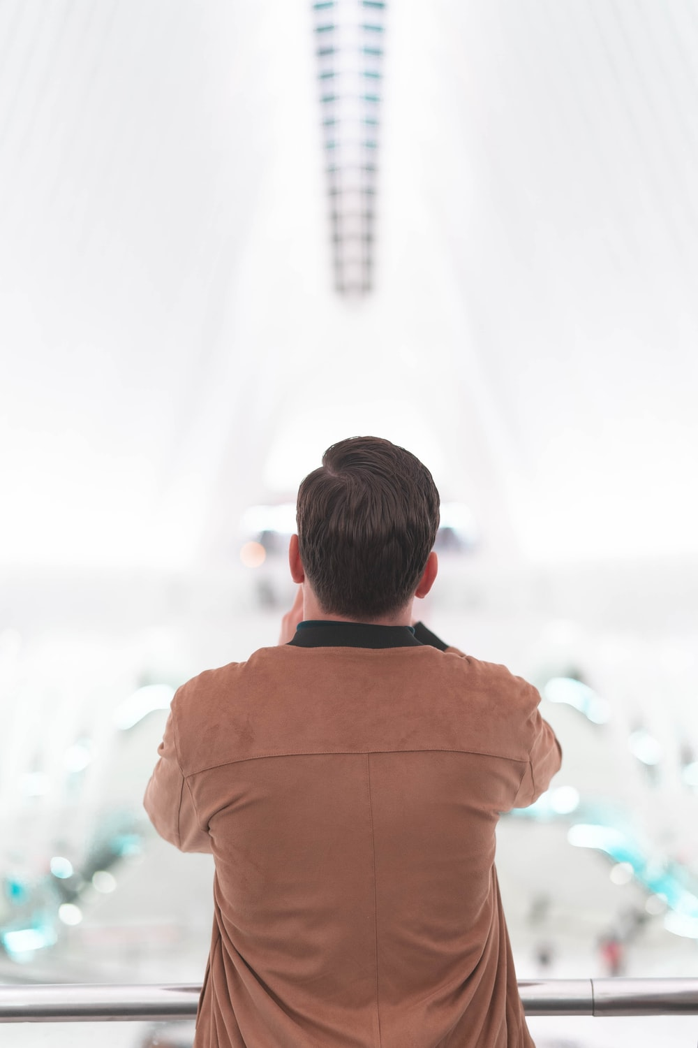 shallow focus photo of person in brown jacket