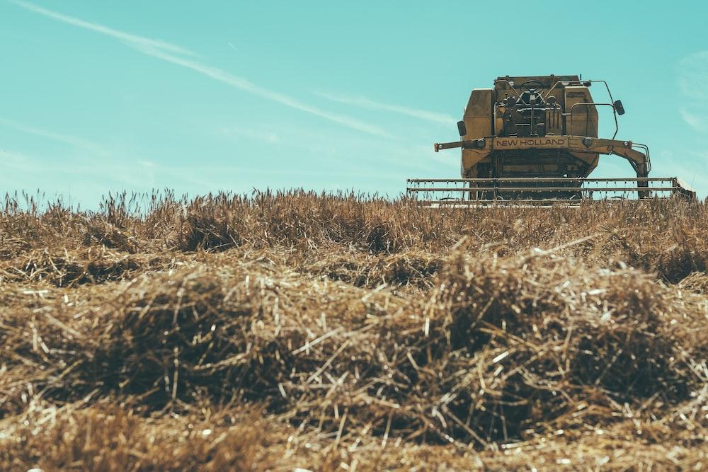 combine harvester under blue sky