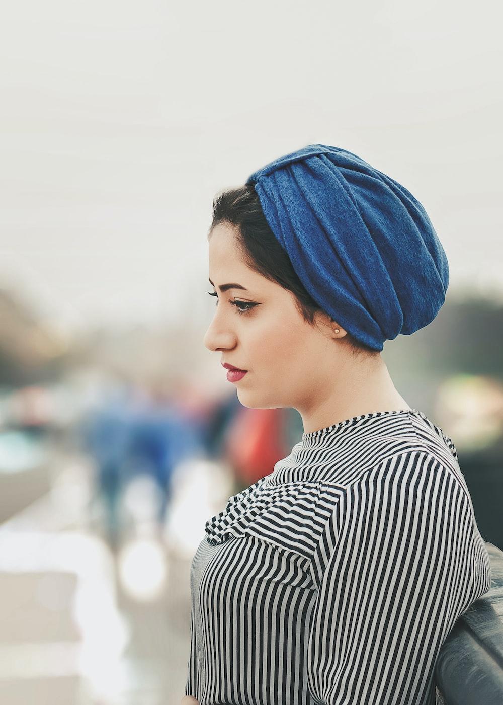 woman wearing blue headdress