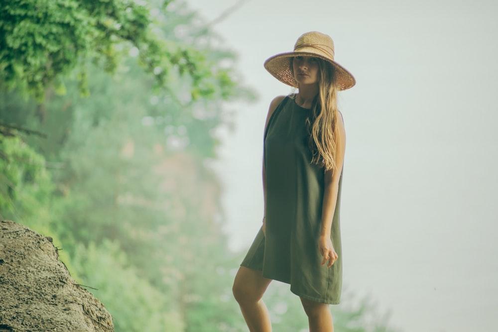 woman standing beside rock photograph