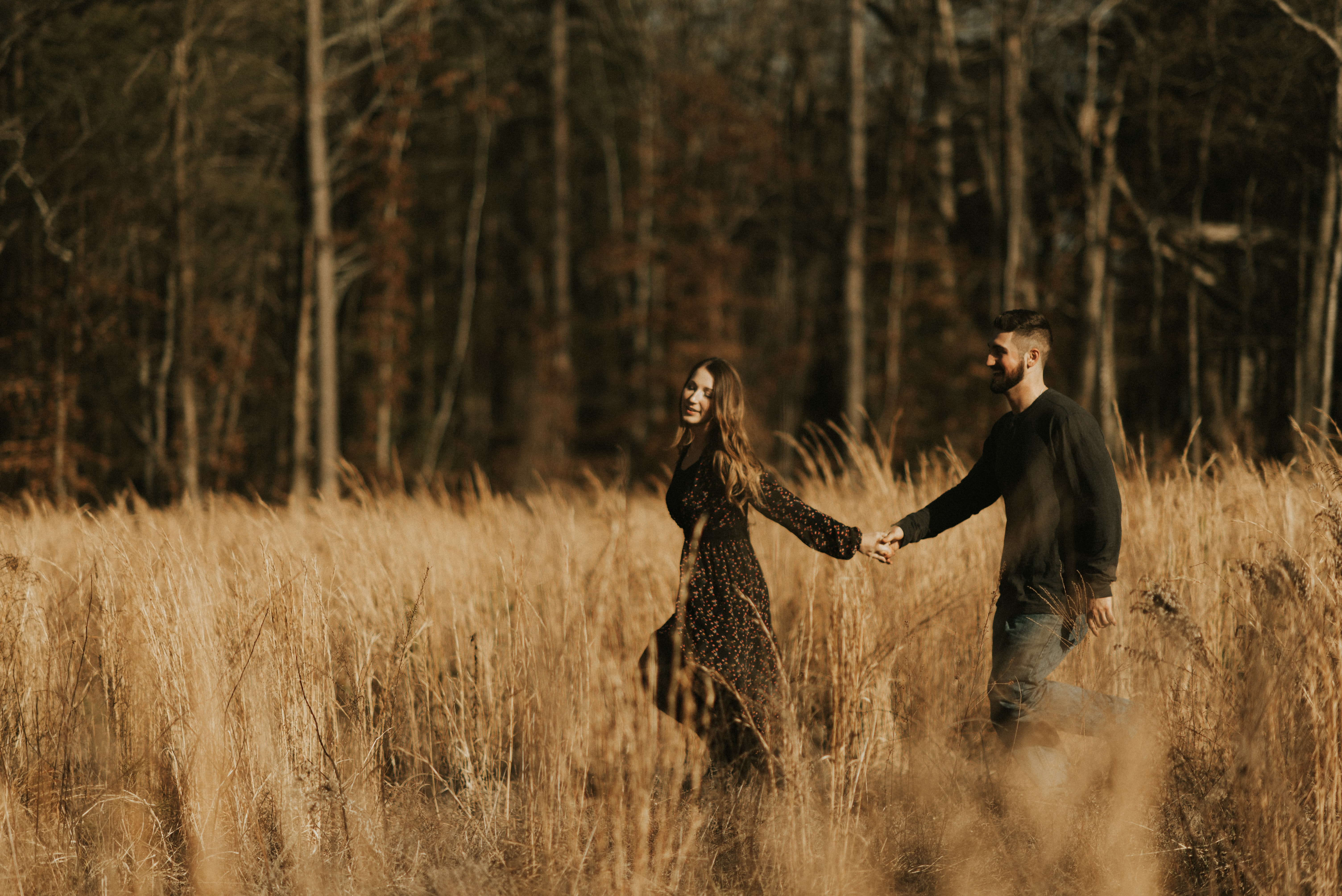 man hand in hand with woman on grass