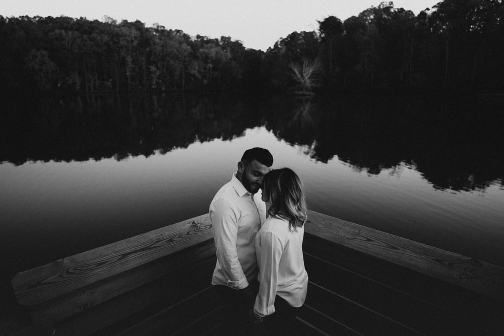 couple facing each other in greyscale photography