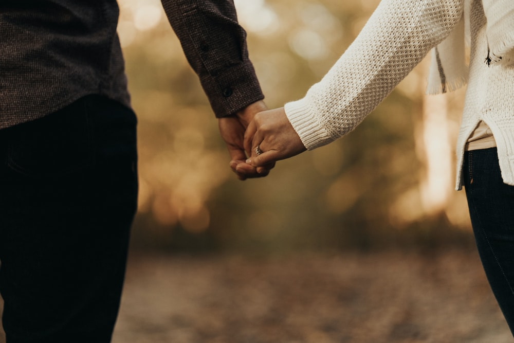woman and man holding hands photo – Free Holding hands Image on Unsplash