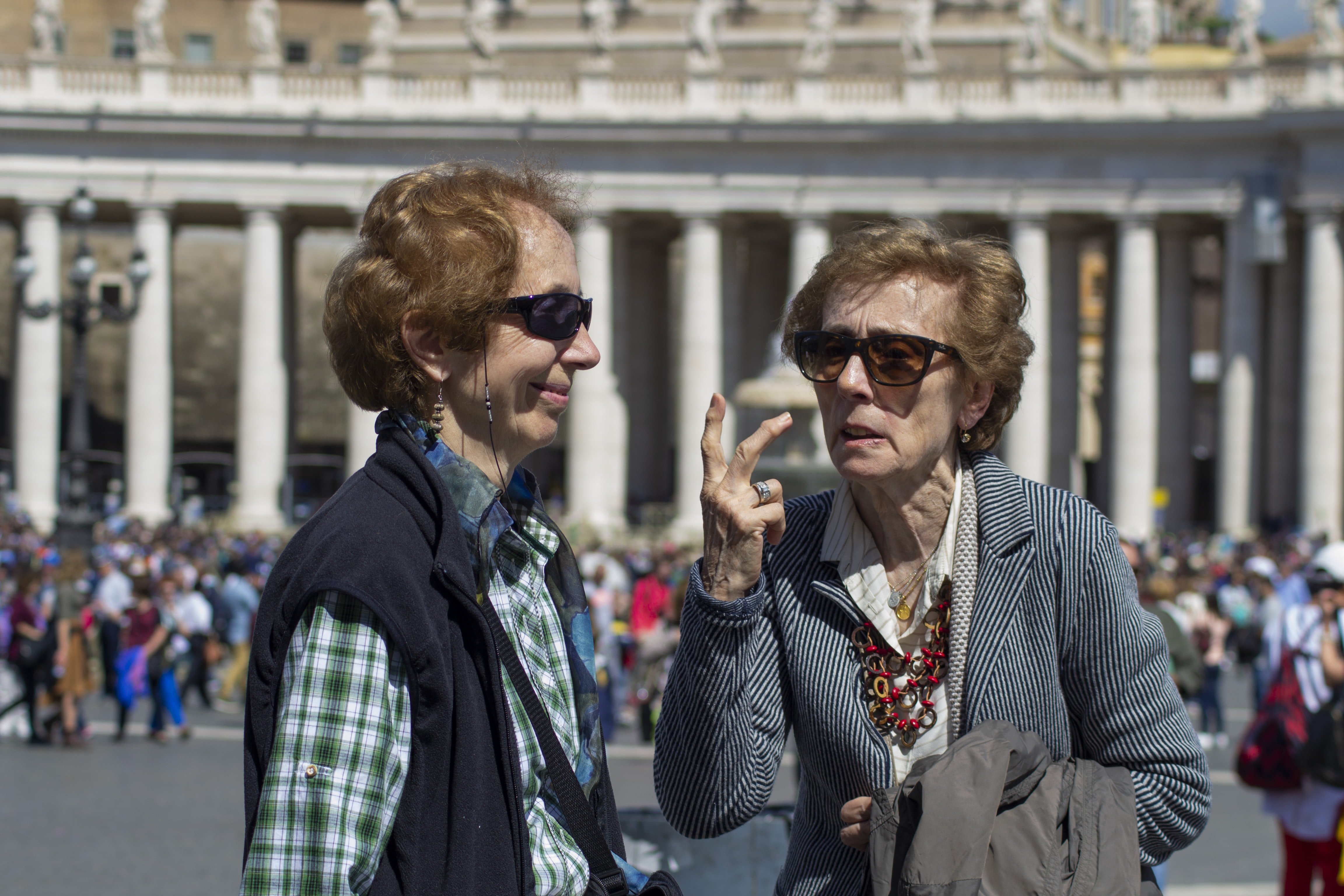 two woman taking in the street