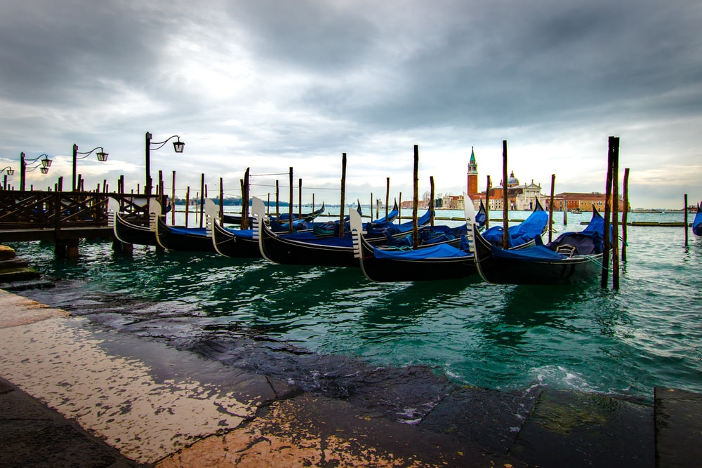 boats on body of water under grey sky