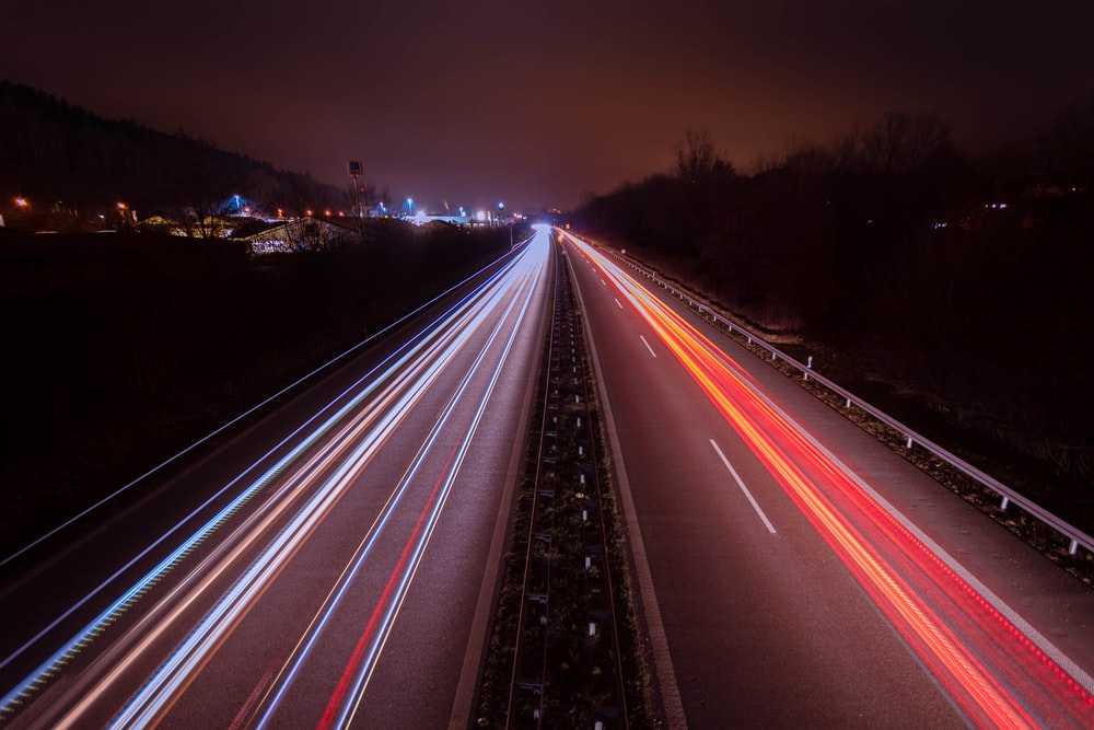 time-lapse photography of cars on road