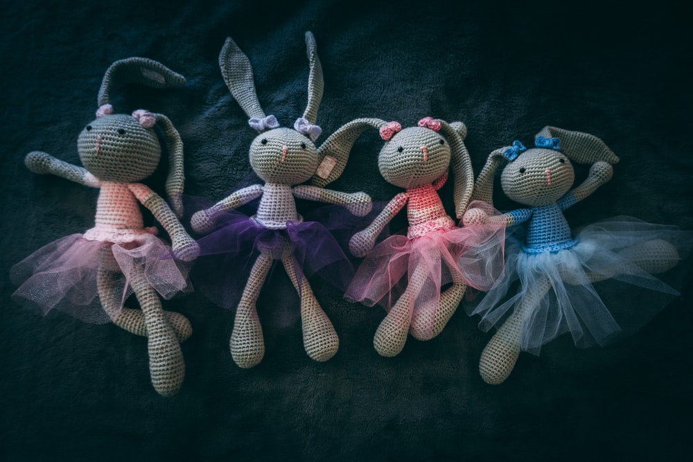 four rabbit knitted dolls