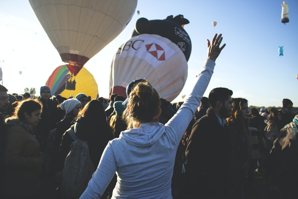 people gathering on hot air balloon site