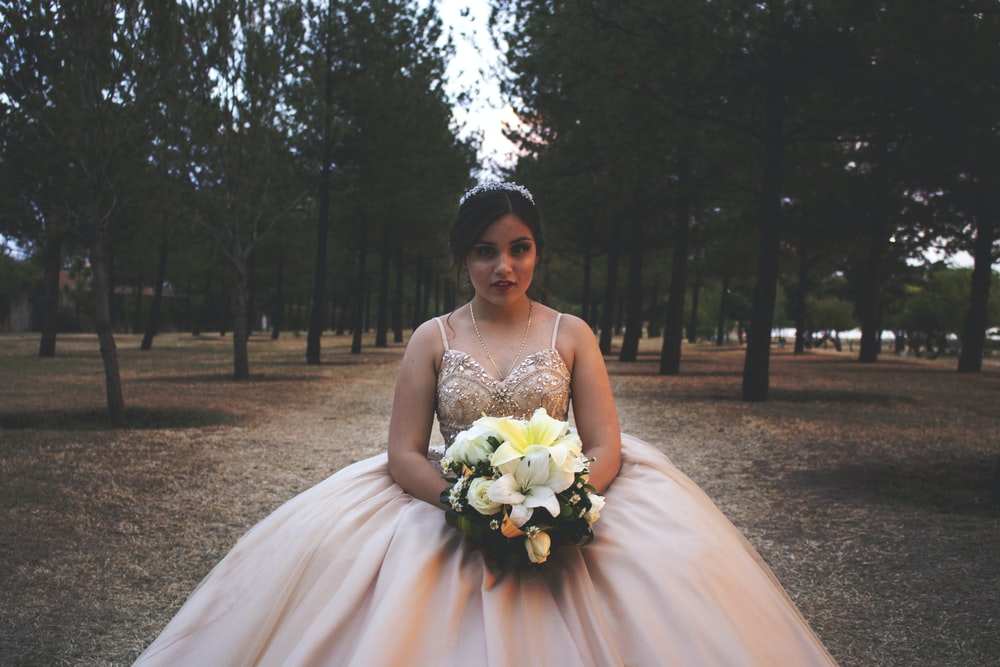 woman wearing brown floral wedding gown