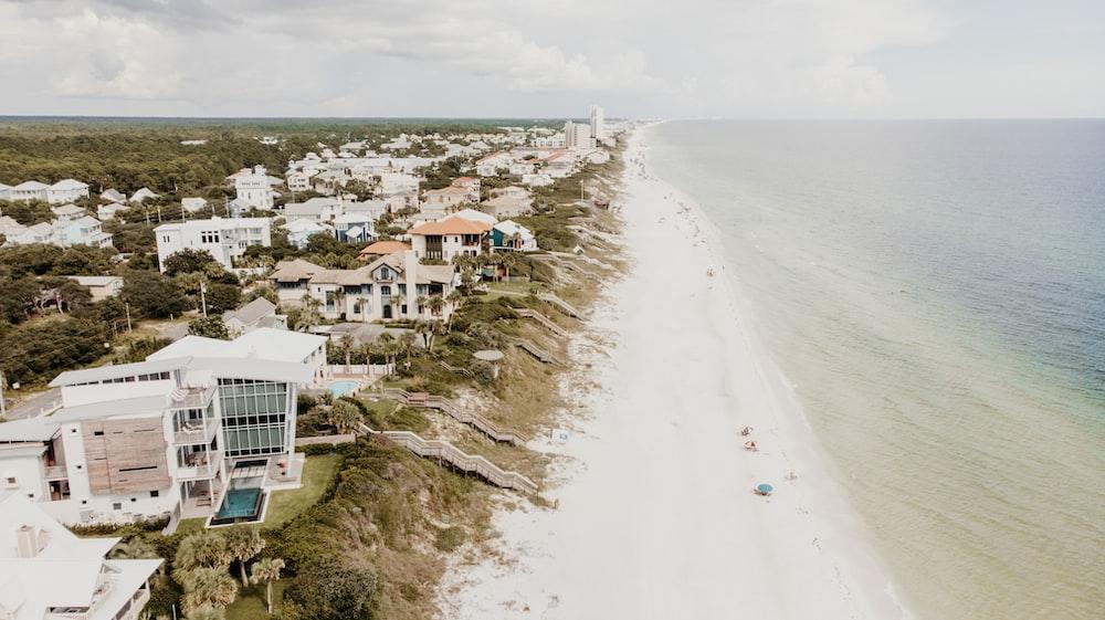 aerial view of houses and buildings facing ocean