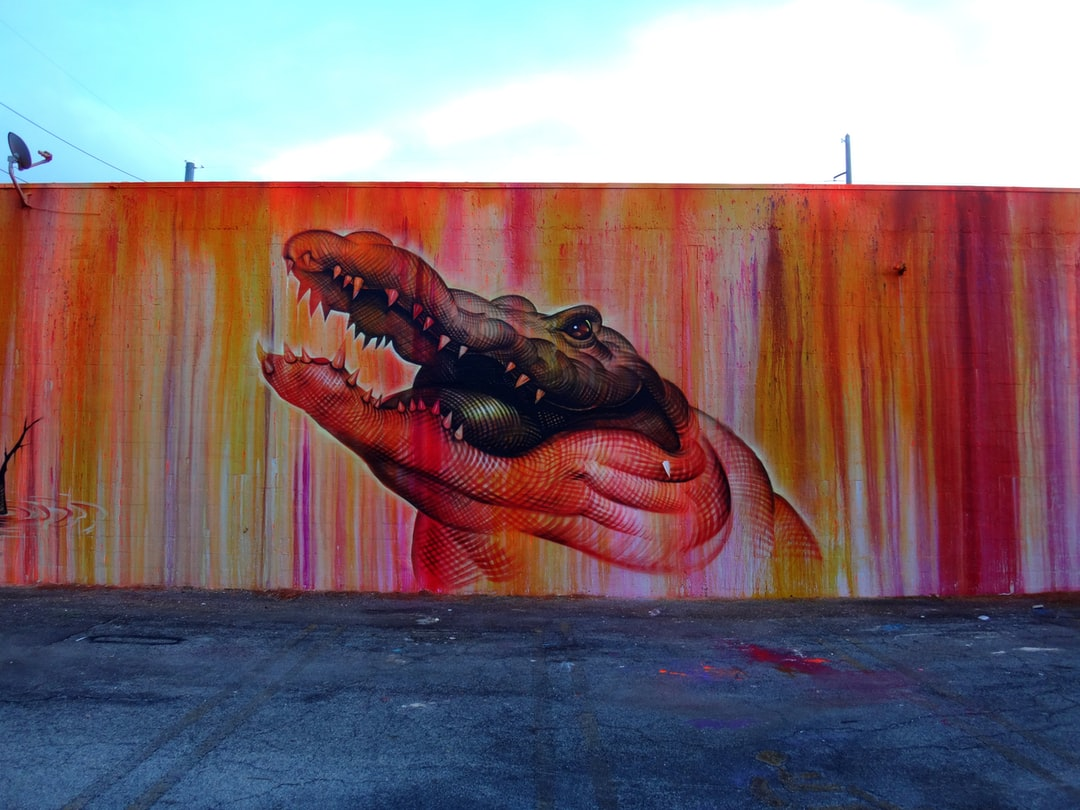 """This is the new mural that covers where the """"Smiles"""" mural used to be in one of my other photos. It is a very colorful yet simple mural just sits next to a parking lot off the main section of the Wynwood neighborhood."""