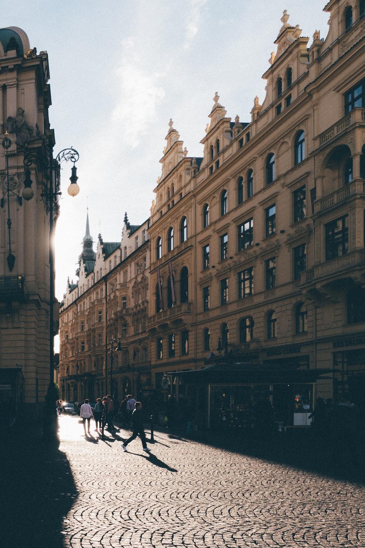 people walking near brown building during daytime