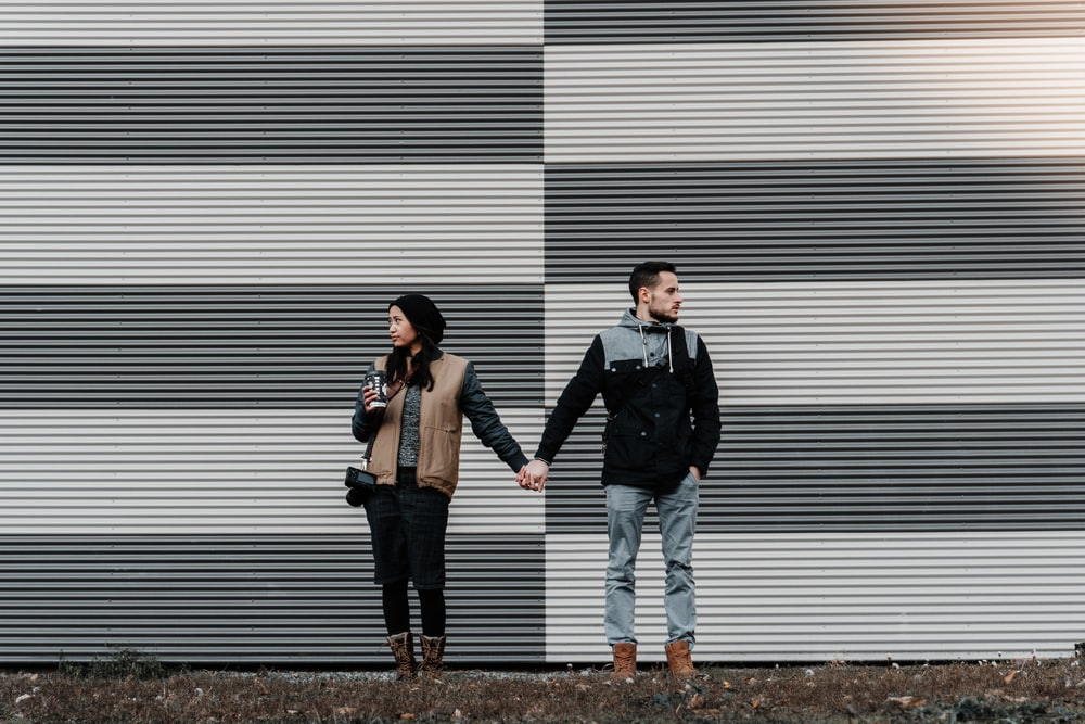 man and woman holding each other's hands