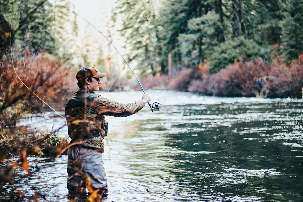 man fishing during daytime