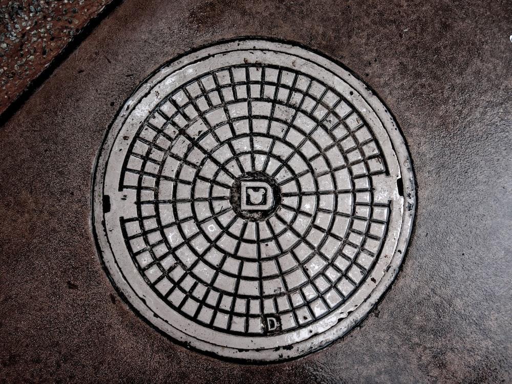 gray manhole cover