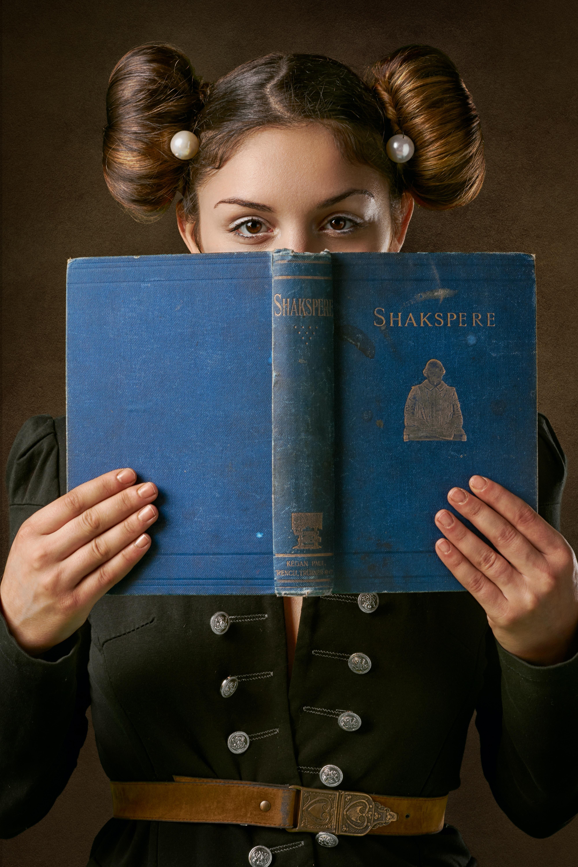 woman holding Shakspere book
