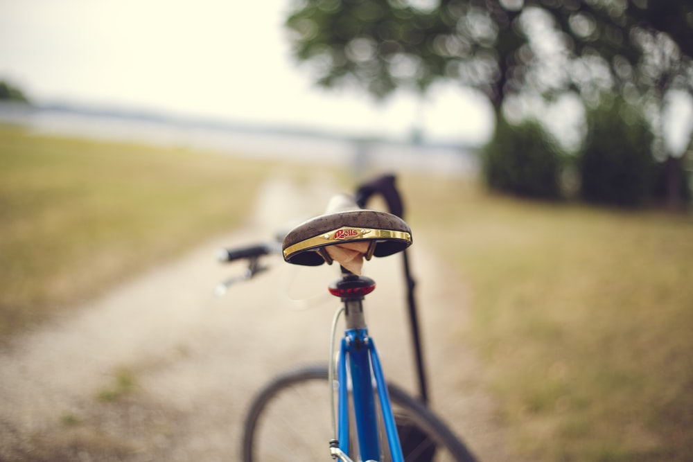 blue bike in selective focus photography