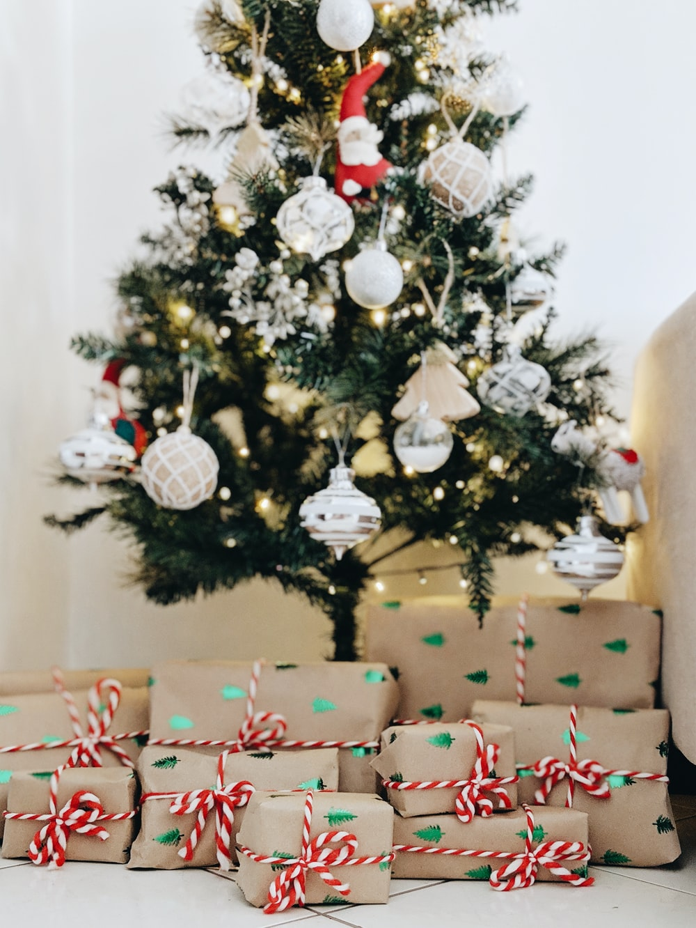 bundle of gifts near Christmas tree