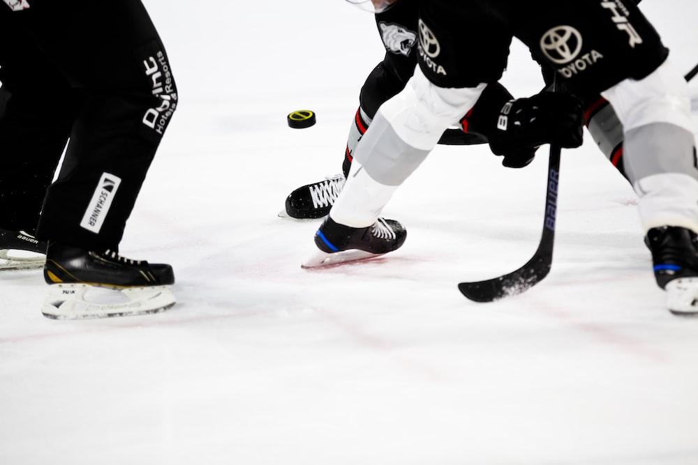 people playing ice hockey