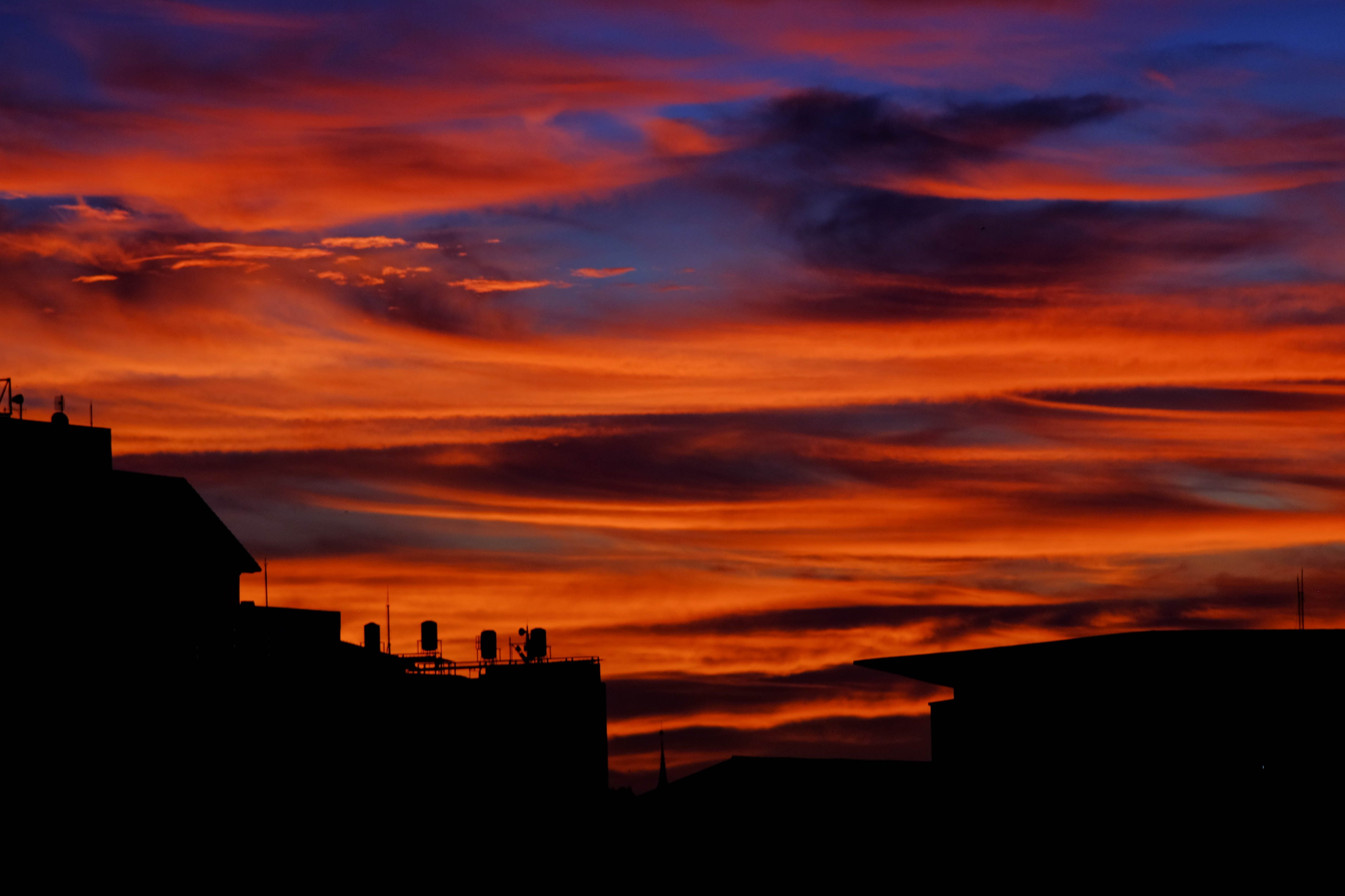 silhouette photography of buildings during sunset