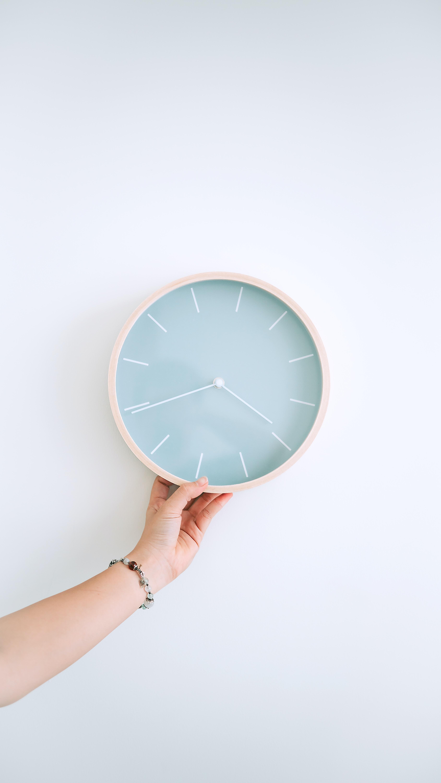 round white analog wall clock