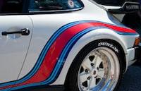 chrome 5-spoke car wheel with tire