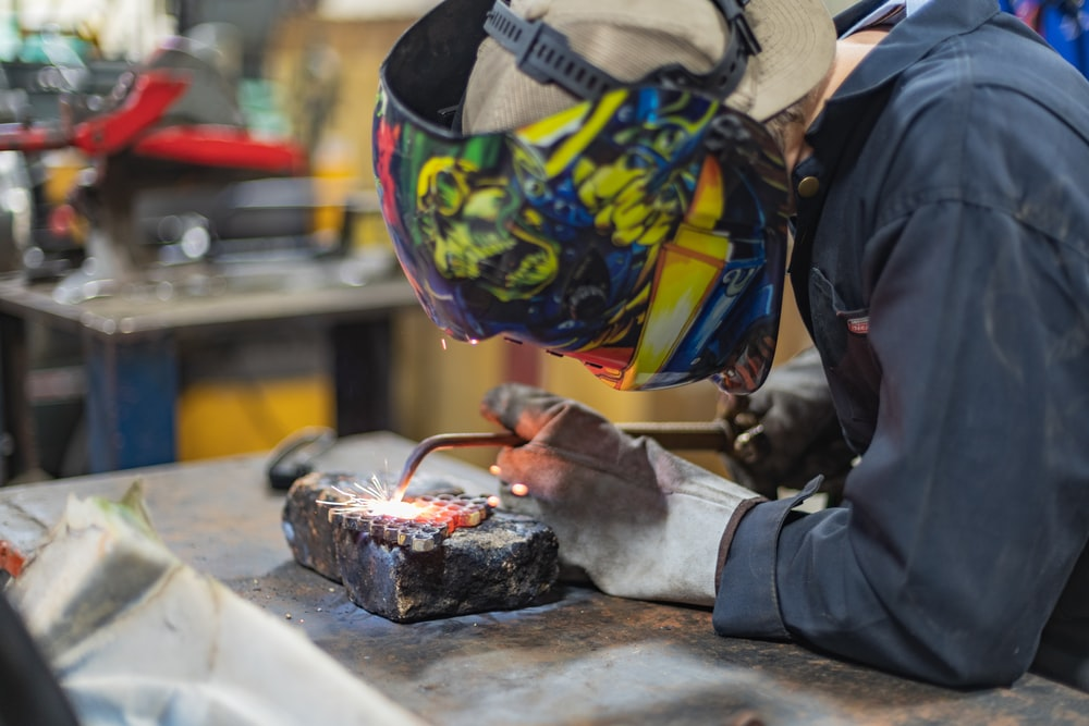 man wearing blue welding mask