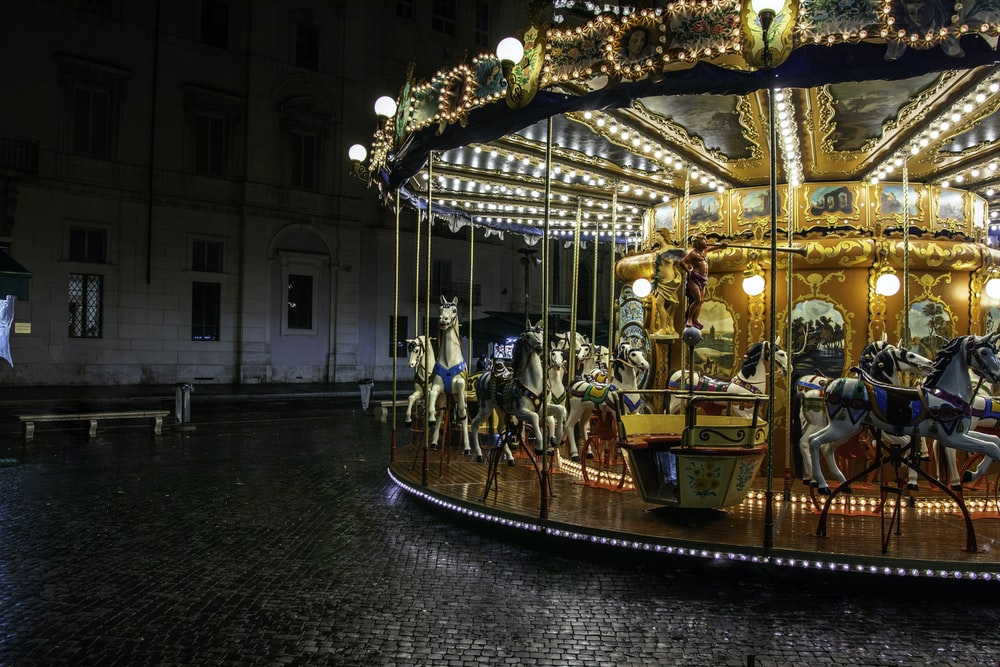 turned-on merry-go-round at nighttime