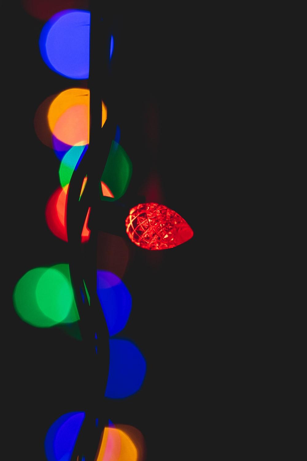 red string light in bokeh photography
