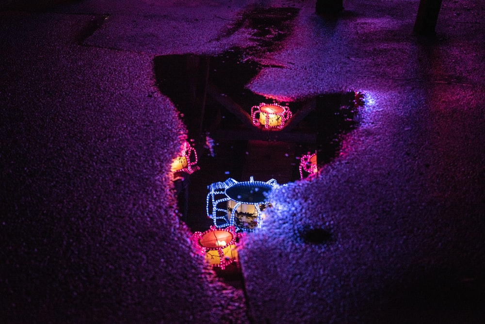 decorative lights reflection on puddle