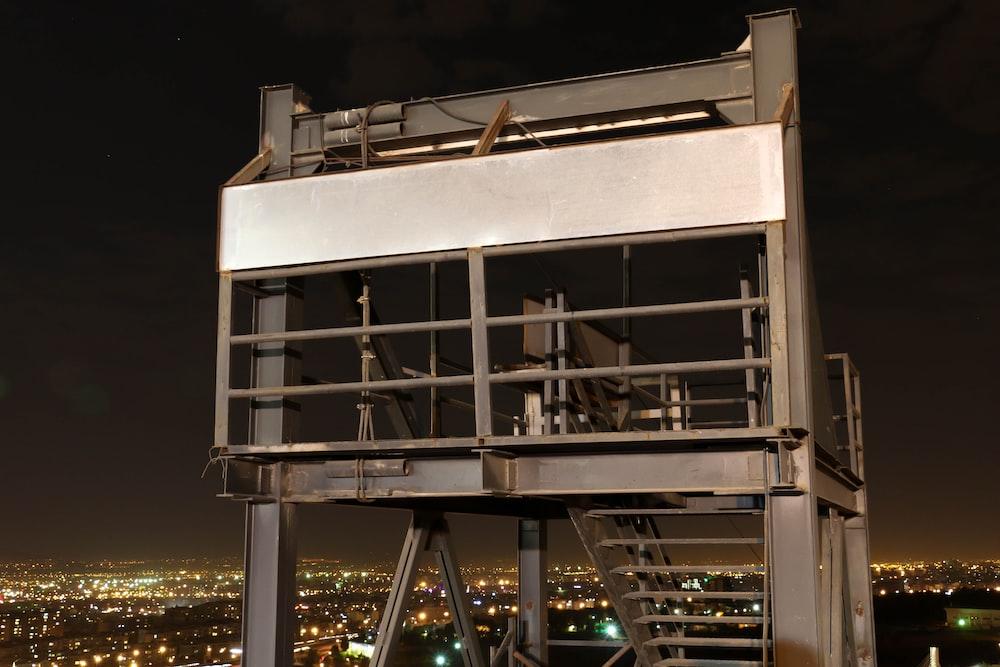 gray metal building overlooking city lights
