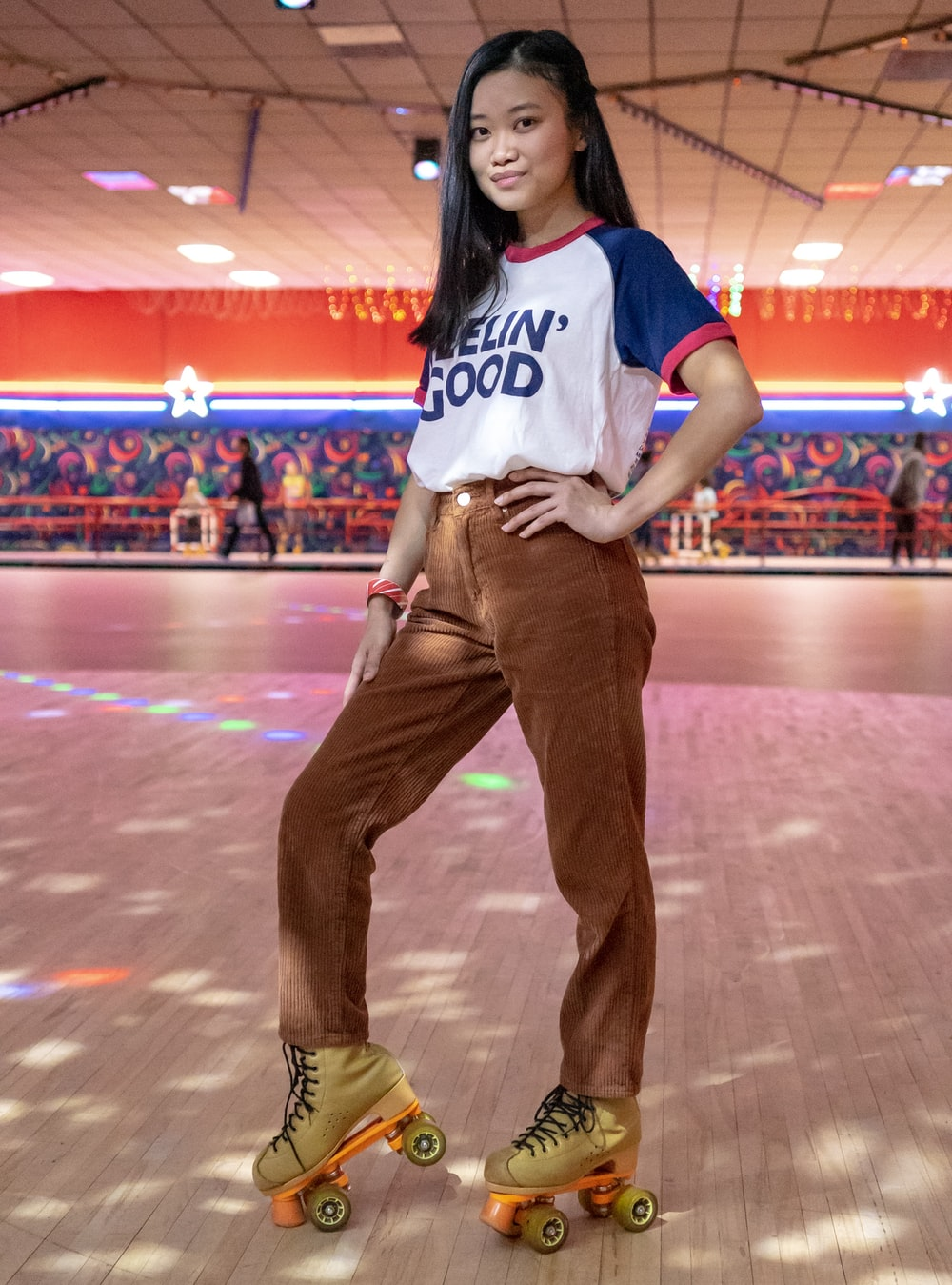 standing woman using roller skates inside building