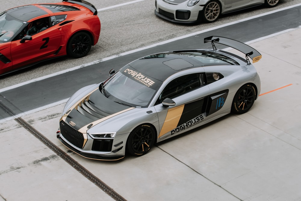 gray and black Audi R8 coupe on asphalt road during daytime
