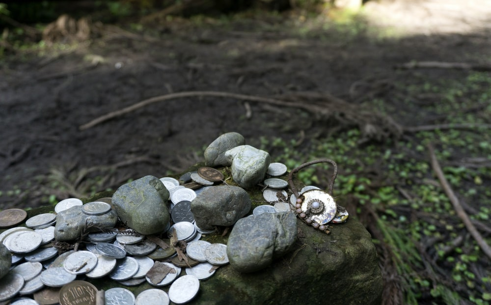 coins and pebbles