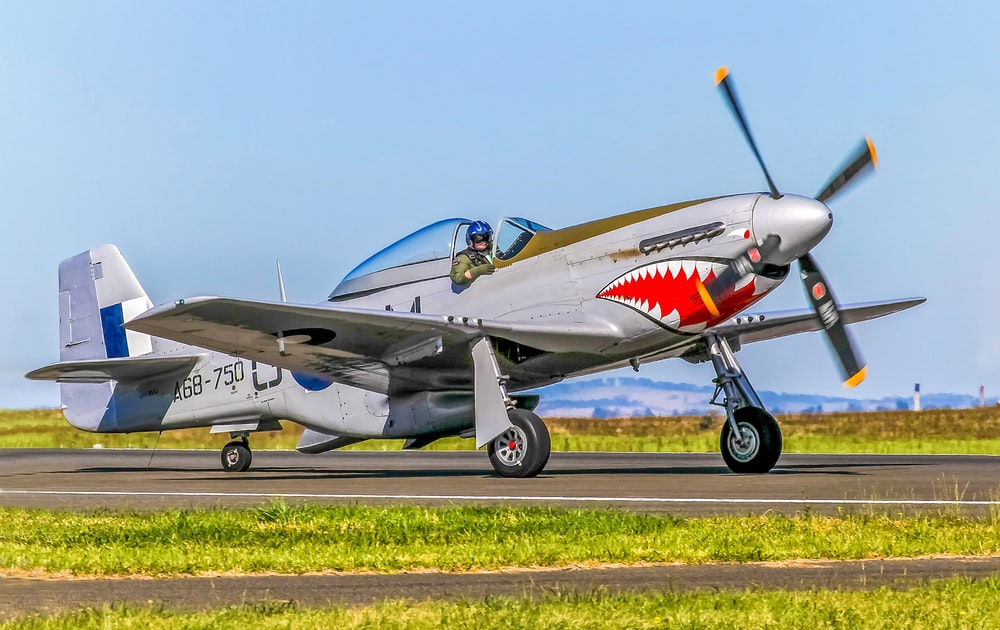 P-51 mustang plane taxiing at airport