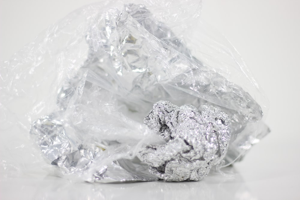 silver-colored stone in plastic pack