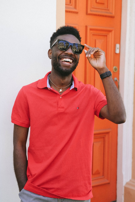 smiling man wearing red polo shirt