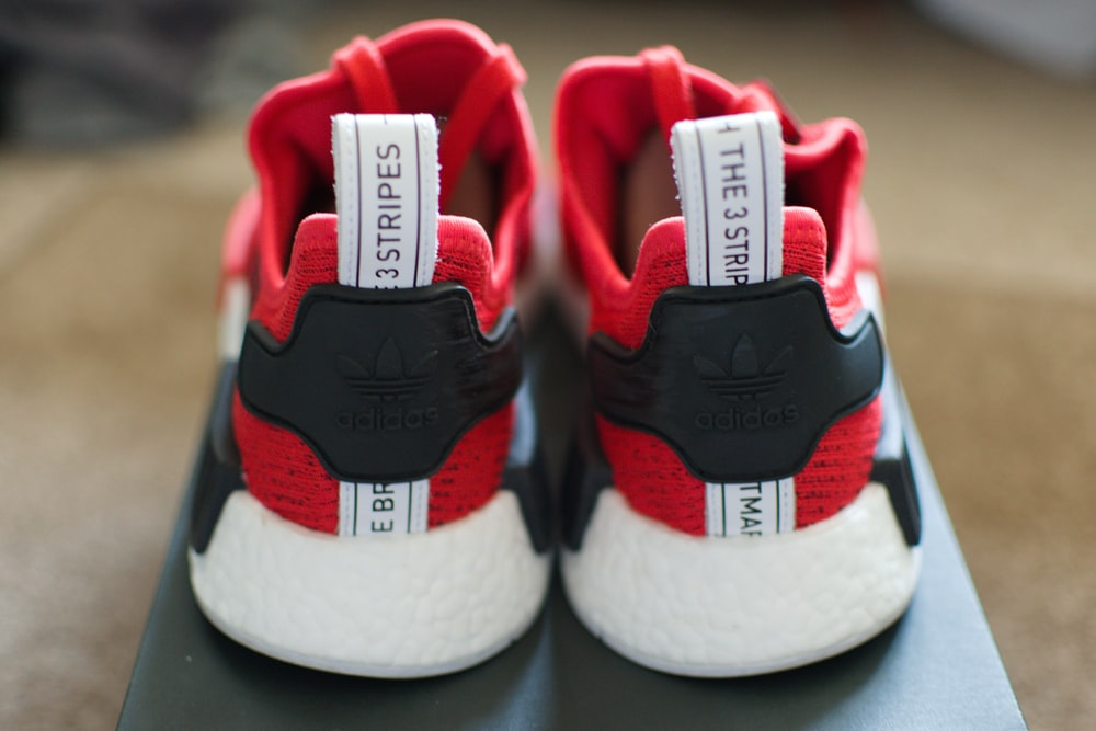 red-and-black 3 Stripes running shoes with box