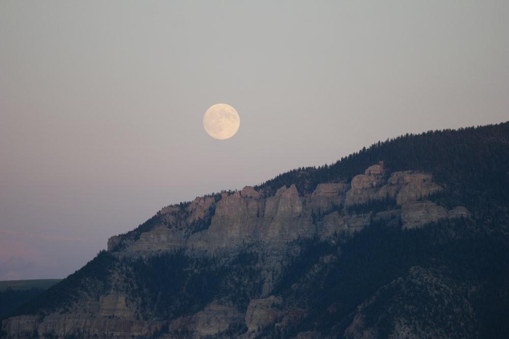 gray mountain under round moon