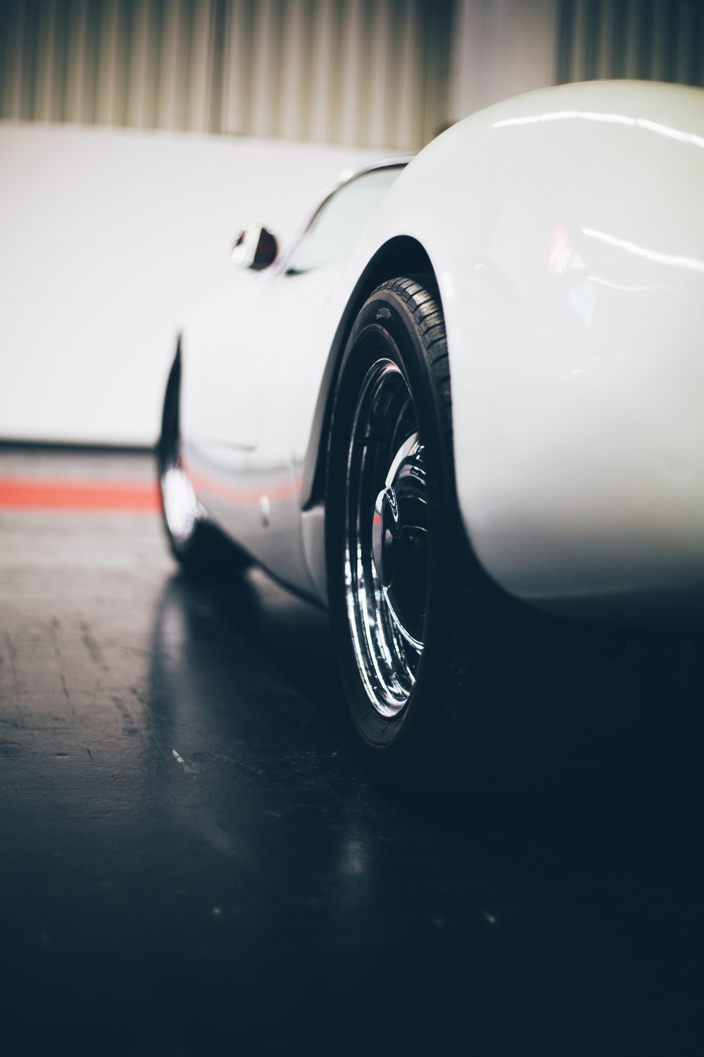 white car parked near wall