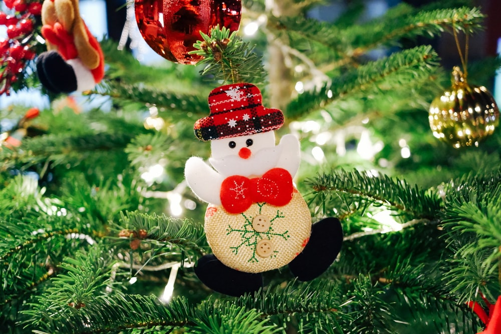 selective focus photography of snowman Christmas ornament