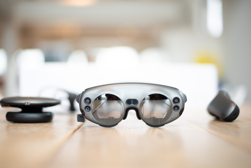 selective focus photography of gray glasses