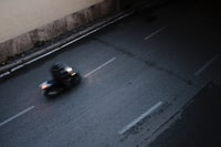 aerial view photography of person driving motorcycle on road