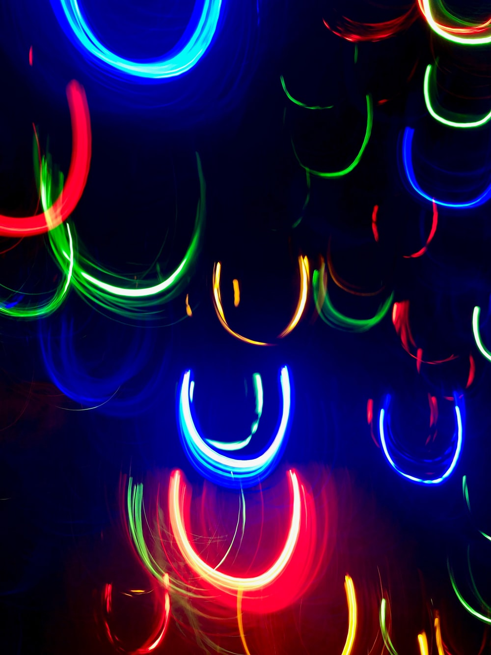 multicolored LED lights hanging during nighttime