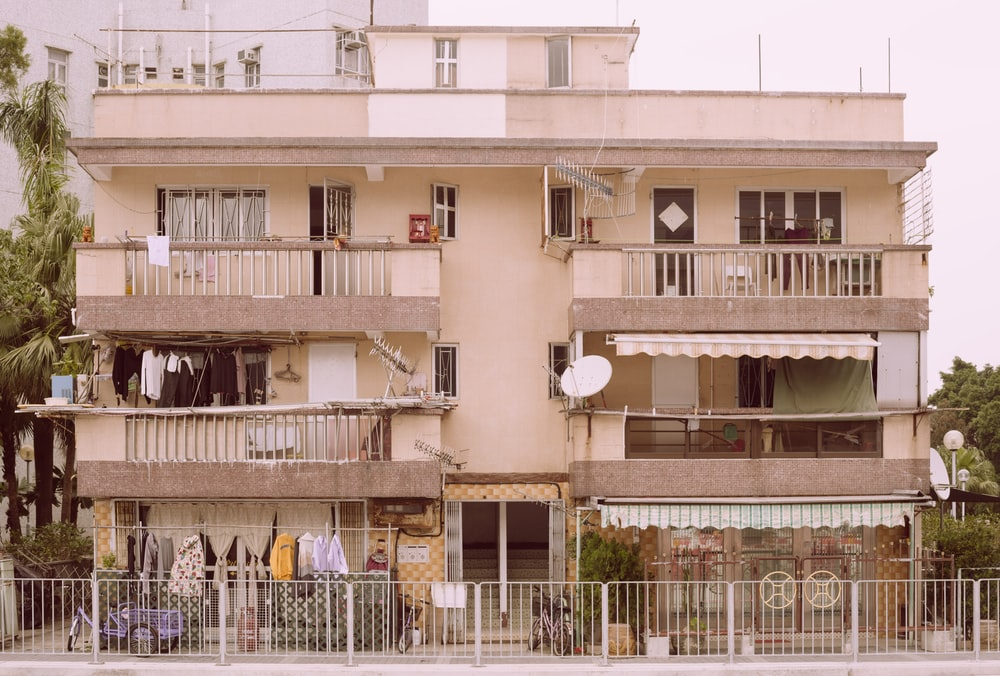 white 3-storey building